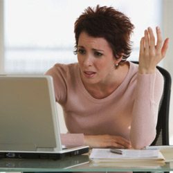 frustrated-woman-using-her-laptop-250-thumb-250x250
